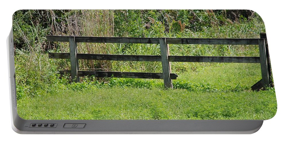 Fence Portable Battery Charger featuring the photograph Natures Fence by Rob Hans