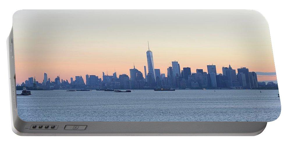 Skyline New York Portable Battery Charger featuring the photograph New York City Skyline At Sunrise by Merijn Van der Vliet