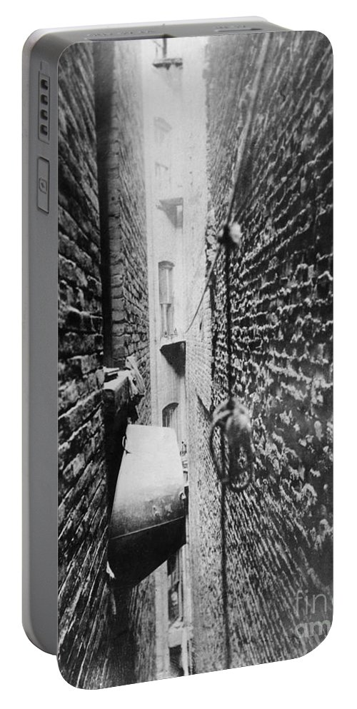 1890 Portable Battery Charger featuring the photograph New York: Tenement, C1890 by Granger
