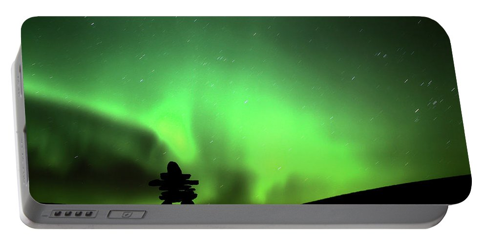 Inukchuk Portable Battery Charger featuring the digital art Northern Light Above An Inukchuk In Saskatchewan by Mark Duffy