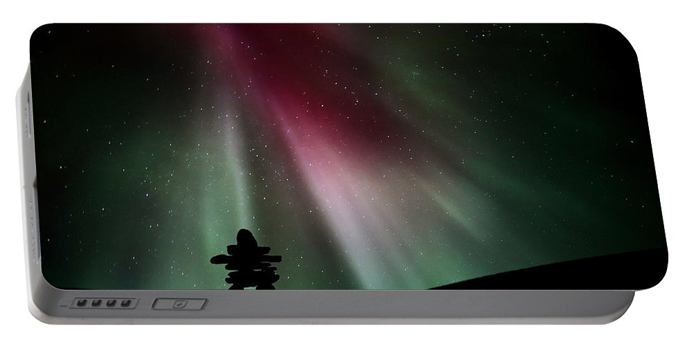Inukchuk Portable Battery Charger featuring the digital art Northern Lights Above An Inukchuk In Saskatchewan by Mark Duffy