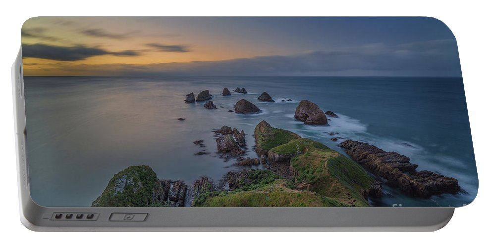 New Zealand Portable Battery Charger featuring the photograph Nugget Point by Kamrul Arifin Mansor
