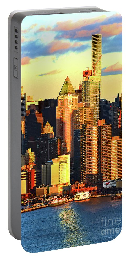 Ny Skyline Sundown Portable Battery Charger featuring the photograph Nyc West Side In Gold And Blue by Regina Geoghan