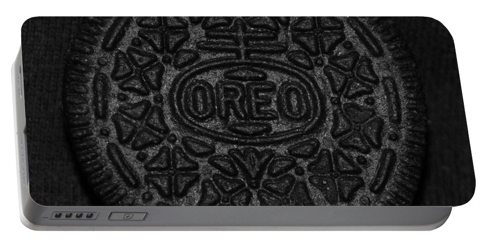 Oreo Portable Battery Charger featuring the photograph O R E O by Rob Hans