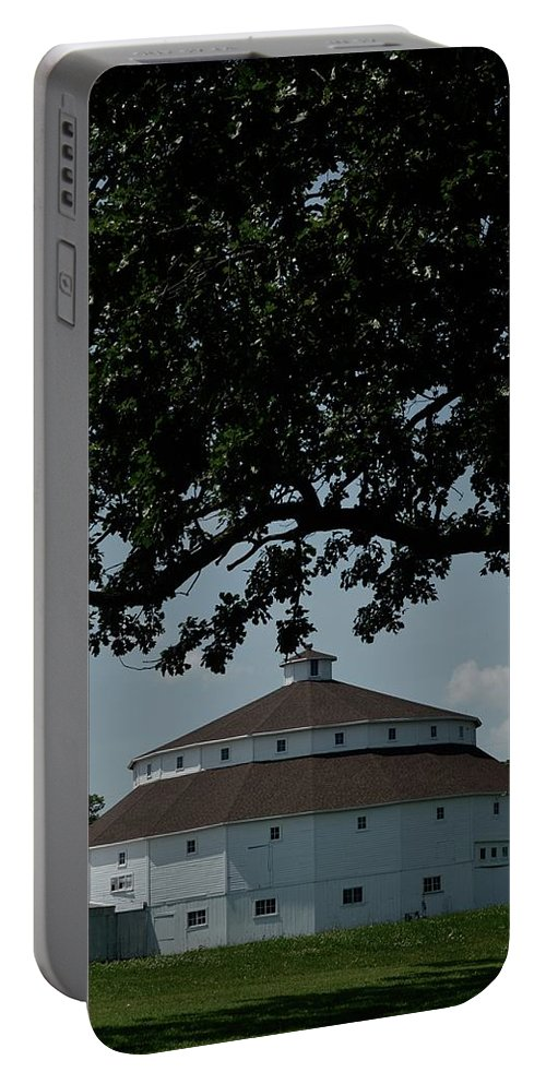 Tiwago Portable Battery Charger featuring the photograph Oak And Round Barn by Photography by Tiwago