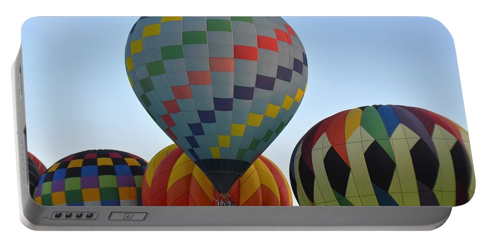 Balloons Portable Battery Charger featuring the photograph Off We Go by Charles HALL