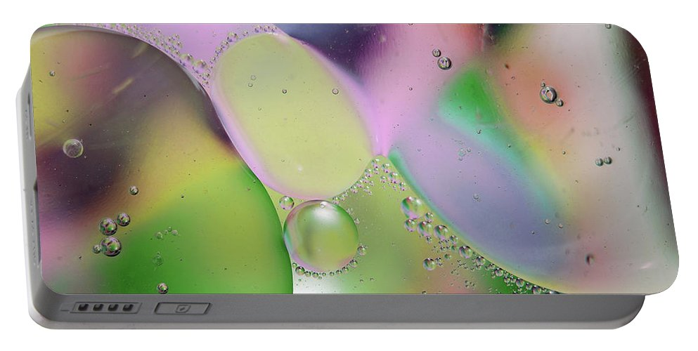 Abstract Portable Battery Charger featuring the photograph Oil 3 by Michael Peychich