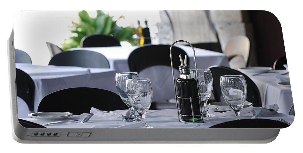 Tables Portable Battery Charger featuring the photograph Oils And Glass At Dinner by Rob Hans