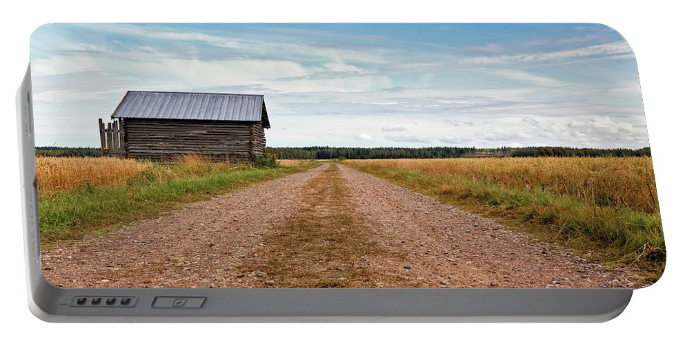 Copy Space Portable Battery Charger featuring the photograph Old Barn By The Gravel Road by Jukka Heinovirta