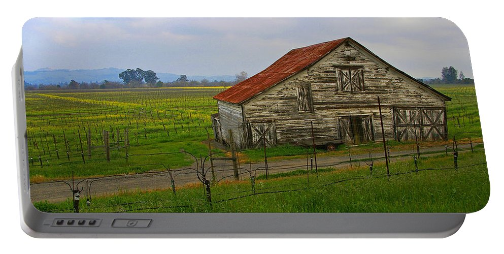Barn Portable Battery Charger featuring the photograph Old Barn In The Mustard Fields by Tom Reynen