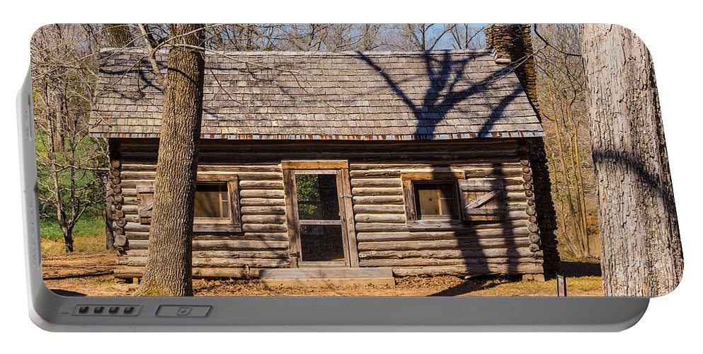 Daffodils Portable Battery Charger featuring the photograph Old Cabin by Darrell Clakley