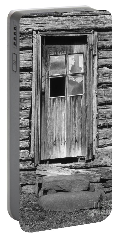 Aged Portable Battery Charger featuring the photograph Old Door by Richard Rizzo