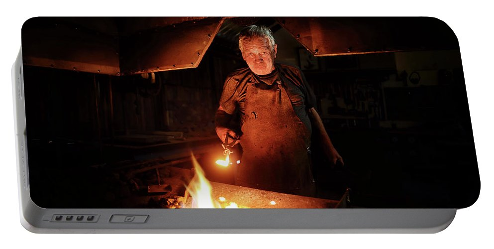 Blacksmith Portable Battery Charger featuring the photograph Old-fashioned Blacksmith Heating Iron by Johan Swanepoel