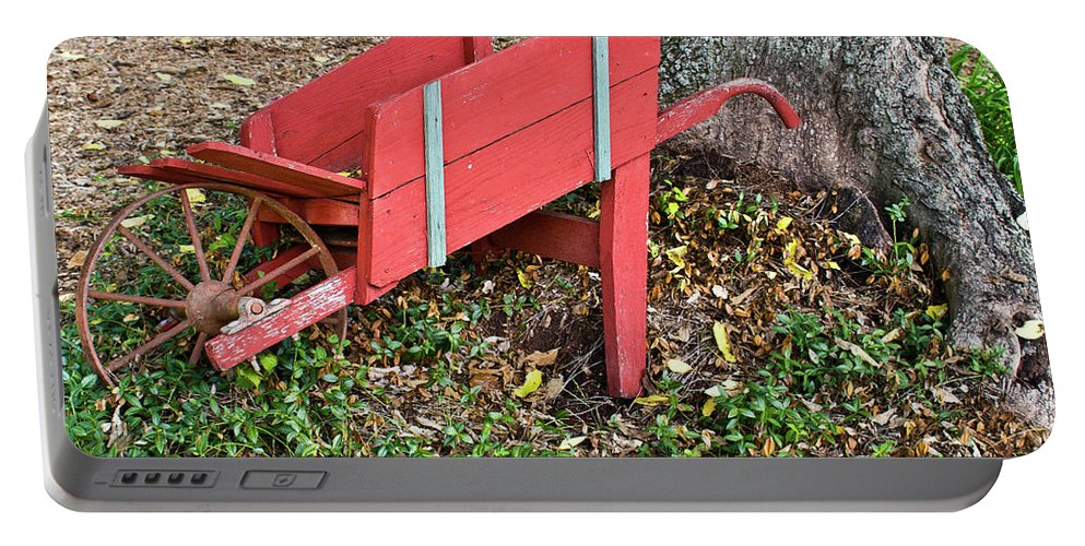 Old Portable Battery Charger featuring the photograph Old Garden Wheel Barrow by Douglas Barnett