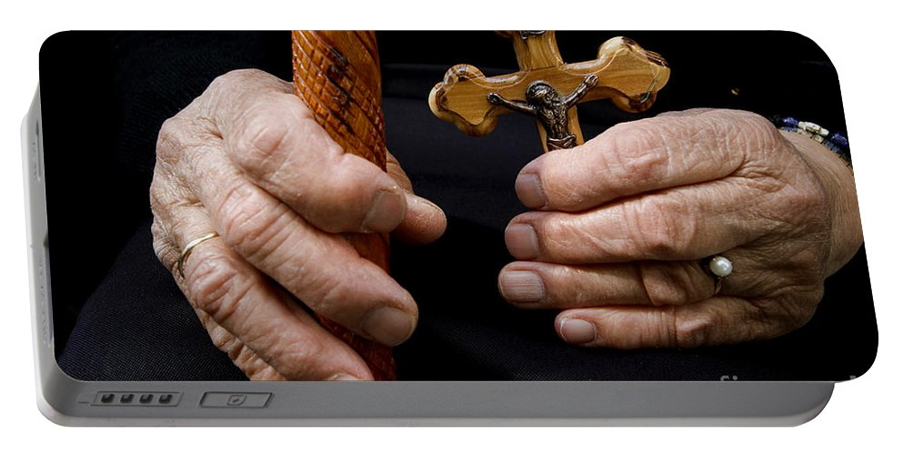 Old Portable Battery Charger featuring the photograph Old Hands And Crucifix by Danny Yanai