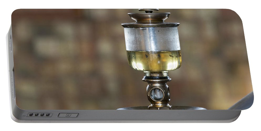 Oil Portable Battery Charger featuring the photograph Old Oil Sight Glass In Industry by Compuinfoto