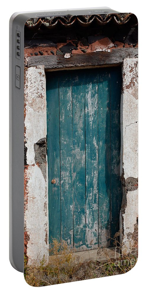 Abandoned Portable Battery Charger featuring the photograph Old Painted Door by Gaspar Avila