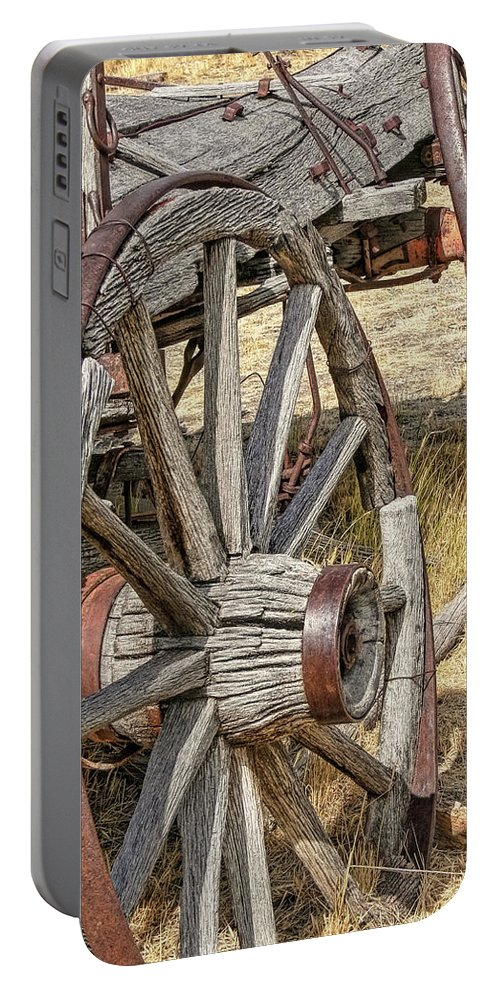 Wheel Portable Battery Charger featuring the photograph Old Wagon Wheels From Montana by Jennie Marie Schell