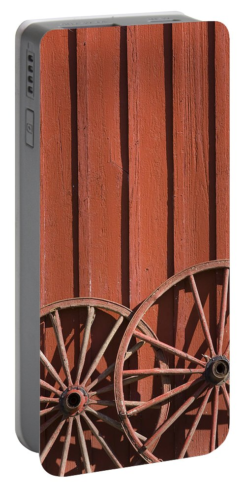 Wheel Wheels Wagon Old Red Barn Antique Past History Rural Country Portable Battery Charger featuring the photograph Old Wagon Wheels IIi by Andrei Shliakhau