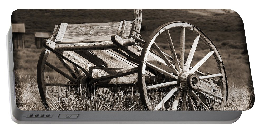 Antique Portable Battery Charger featuring the photograph Old Wheels 2 by Kelley King