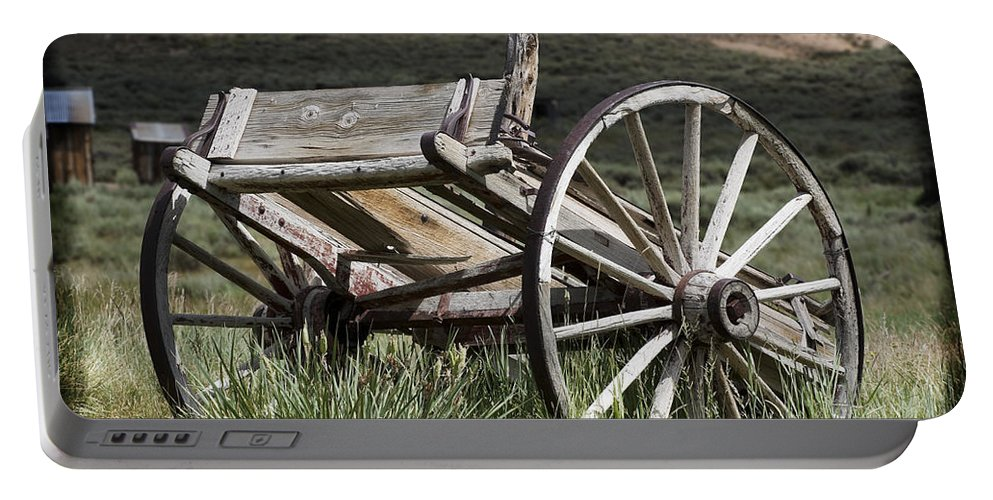 Antique Portable Battery Charger featuring the photograph Old Wheels by Kelley King