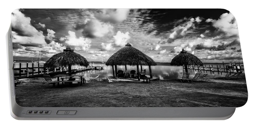 Huts Portable Battery Charger featuring the photograph On The Island by Kevin Cable