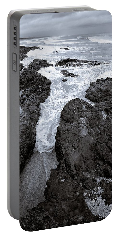 New Zealand Portable Battery Charger featuring the photograph On The Rocks by Dave Bowman