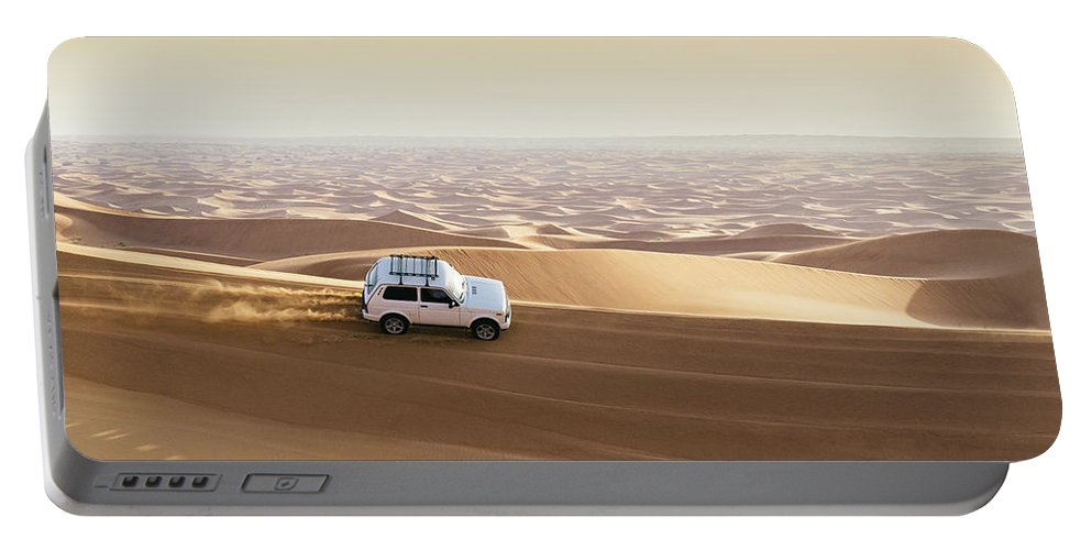 4x4 Portable Battery Charger featuring the photograph One 4x4 Vehicle Off-roading In The Red Sand Dunes Of Dubai Emirates, United Arab Emirates by Alexandre Rotenberg
