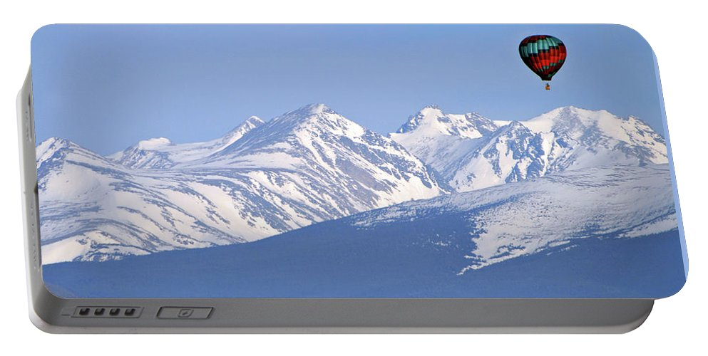 Rockies Portable Battery Charger featuring the photograph Over The Rockies by Scott Mahon