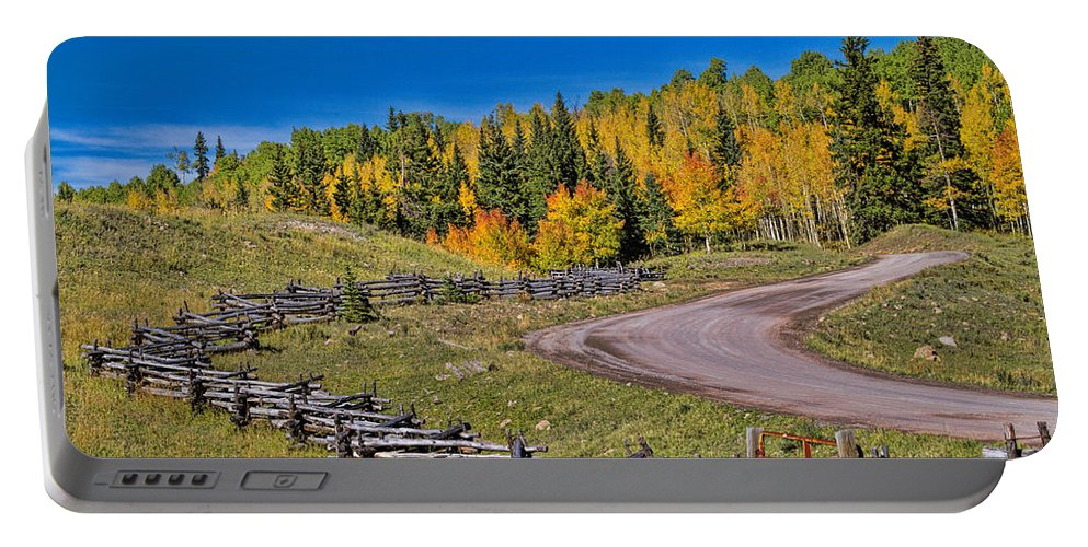 Fall Color Portable Battery Charger featuring the photograph Owl Creek Pass Road by Alana Thrower