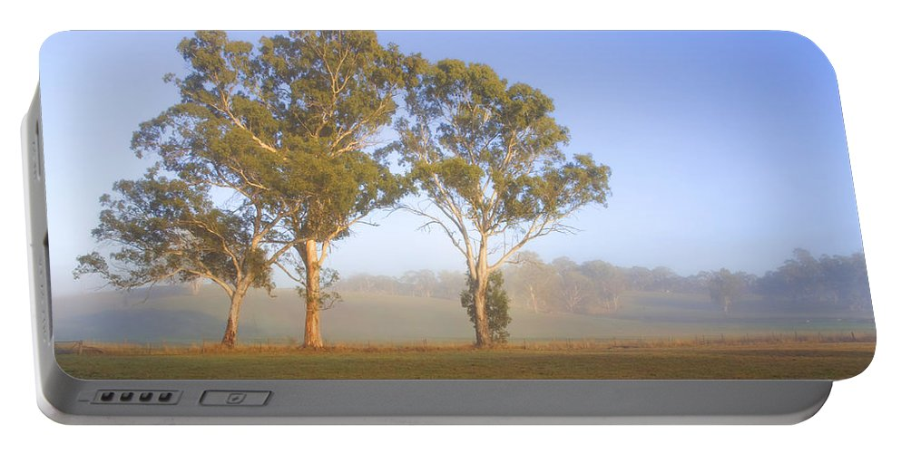 Gum Portable Battery Charger featuring the photograph Paddock Sunrise by Mike Dawson