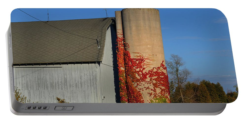 Fall Portable Battery Charger featuring the photograph Painted Silo by Tim Nyberg