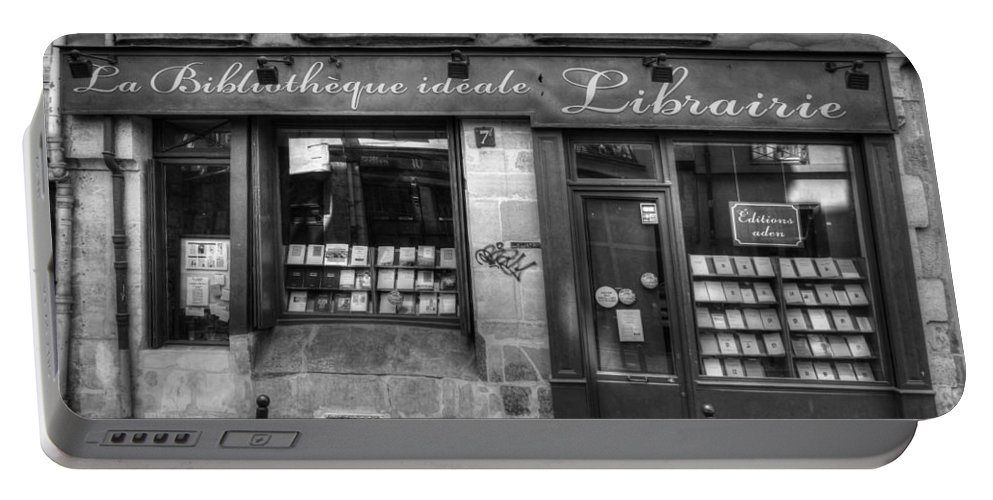 Paris Portable Battery Charger featuring the photograph Paris France Book Store Library Black And White by Toby McGuire
