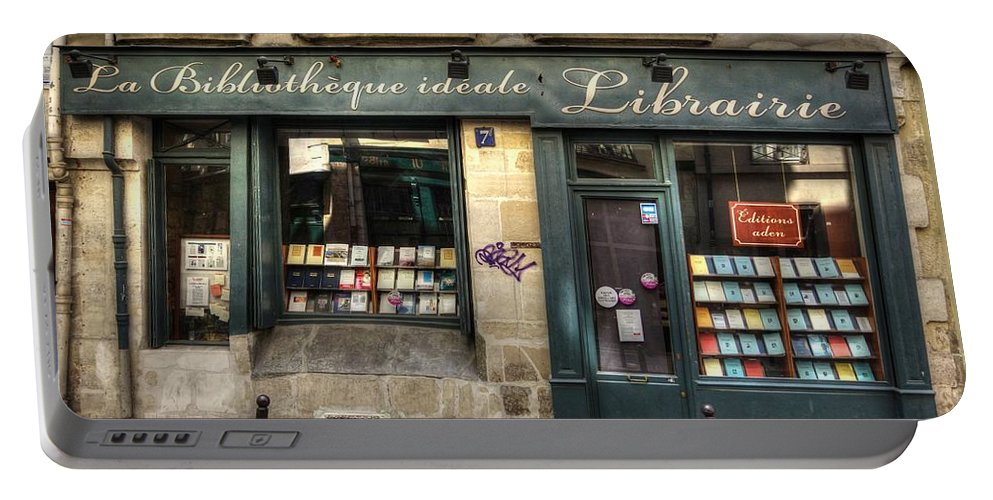Paris Portable Battery Charger featuring the photograph Paris France Book Store Library by Toby McGuire