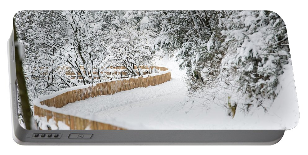 Snow Portable Battery Charger featuring the photograph Path In Snow by Nicola Simeoni