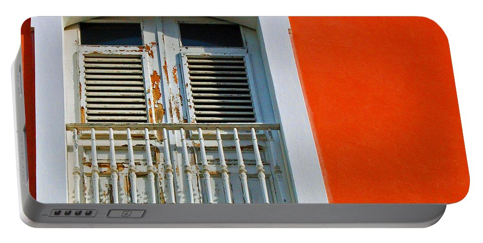 Shutters Portable Battery Charger featuring the photograph Peel An Orange by Debbi Granruth