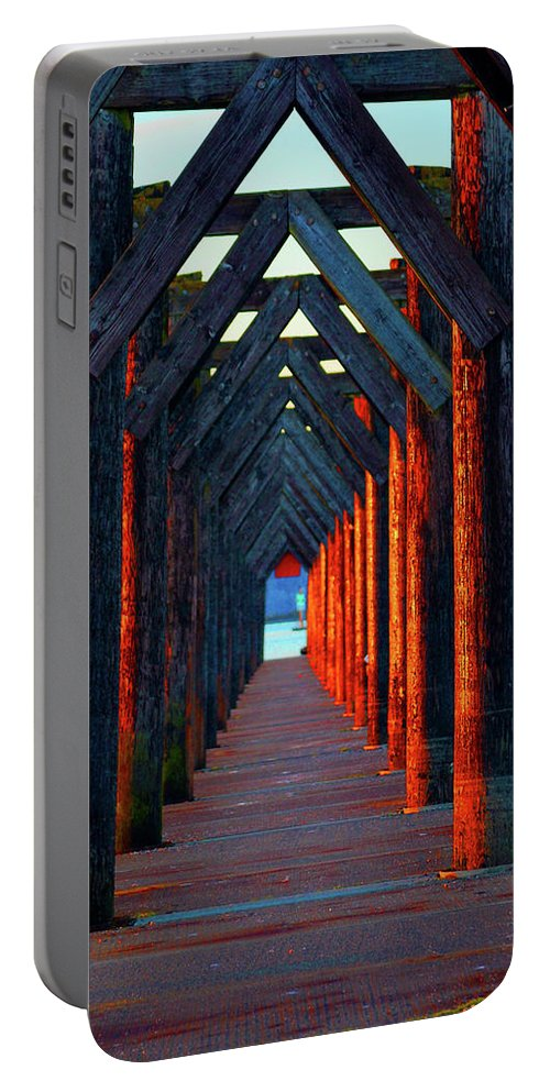 Sunset Portable Battery Charger featuring the photograph Pier Symmetry  by Brian O'Kelly