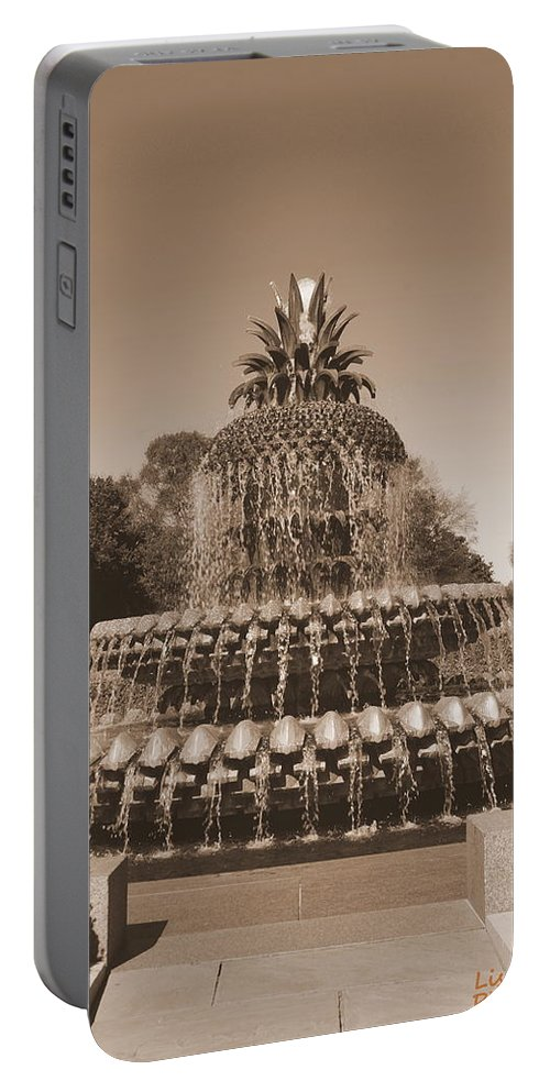 Pineapple Fountain Portable Battery Charger featuring the photograph Pineapple Fountain Charleston S C Sepia by Lisa Wooten