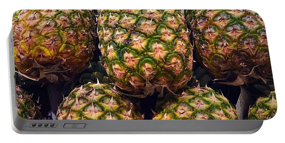 Pineapple Portable Battery Charger featuring the photograph Pineapples by Bri Lou
