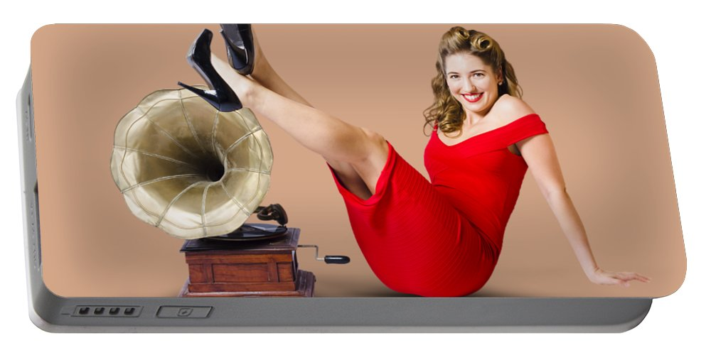 Woman Portable Battery Charger featuring the photograph Pinup Girl In Red Dress Playing Classical Music by Jorgo Photography - Wall Art Gallery