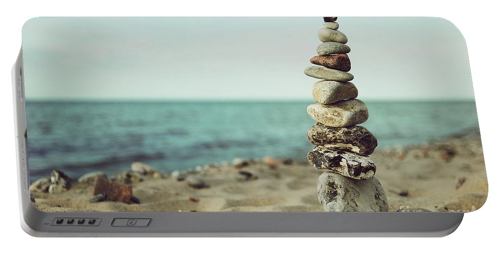 Stones Portable Battery Charger featuring the photograph Poised by Hannes Cmarits