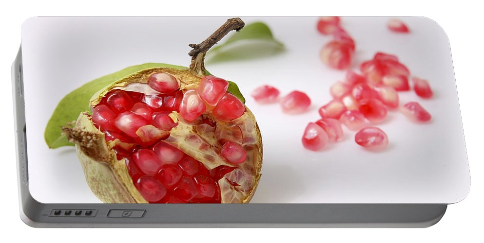 Pomegranate Portable Battery Charger featuring the photograph Pomegranate And Seeds by Yedidya yos mizrachi