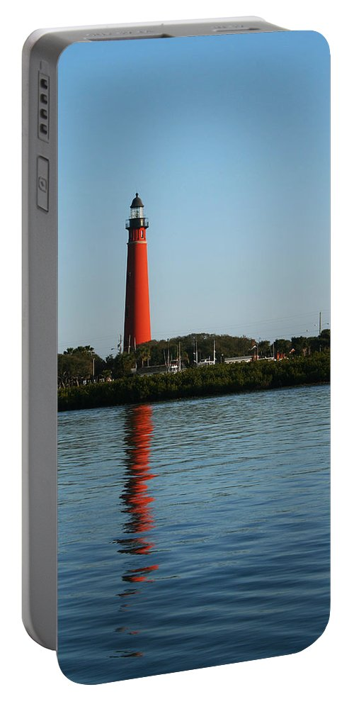 Lighthouse Tall Red Water Reflection Fl Sky Blue Wave Ripple Inlet Travel Tourist Vacation Portable Battery Charger featuring the photograph Ponce Inlet Lighthouse by Andrei Shliakhau