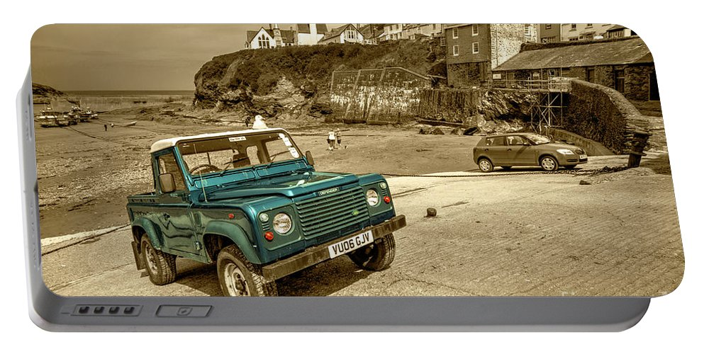 Port Portable Battery Charger featuring the photograph Port Isaac Defender by Rob Hawkins