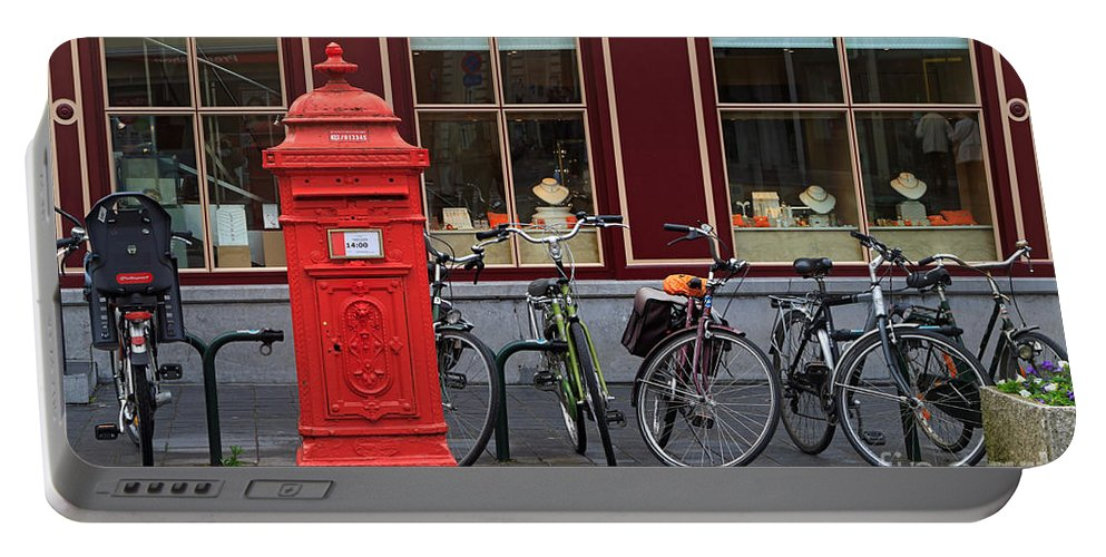 Postbox Portable Battery Charger featuring the photograph Postbox And Bicycles In Front Of The Diamond Museum In Bruges by Louise Heusinkveld