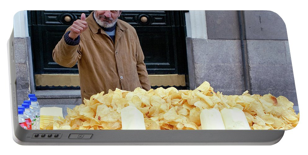 Madrid Portable Battery Charger featuring the photograph Potato Chip Man by Lorraine Devon Wilke