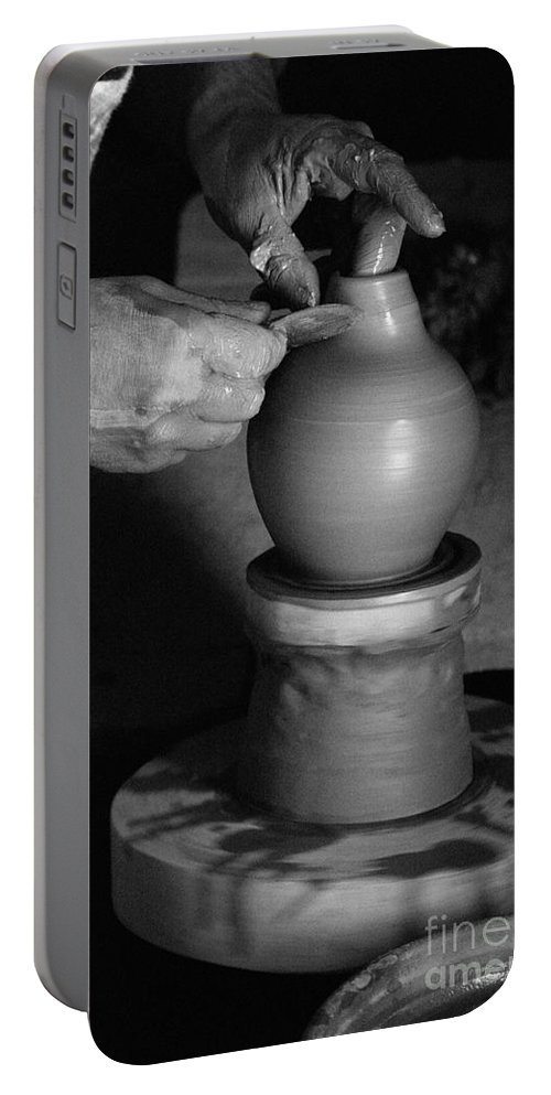 Azores Portable Battery Charger featuring the photograph Potter At Work by Gaspar Avila