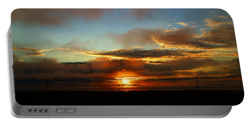 Sunset Portable Battery Charger featuring the photograph Prudhoe Bay Sunset by Anthony Jones