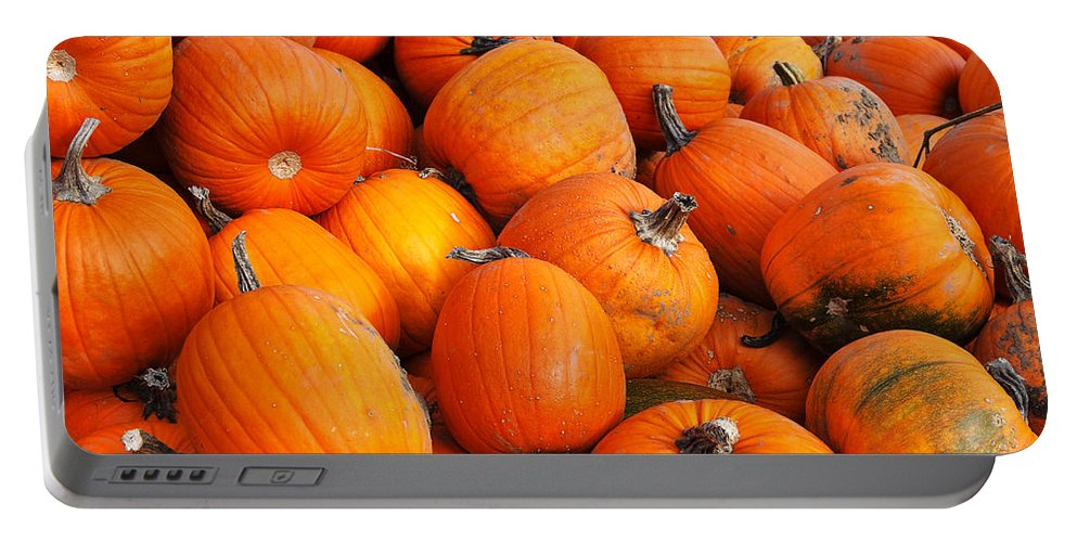 Pumpkin Portable Battery Charger featuring the photograph Pumpkins by Louise Heusinkveld