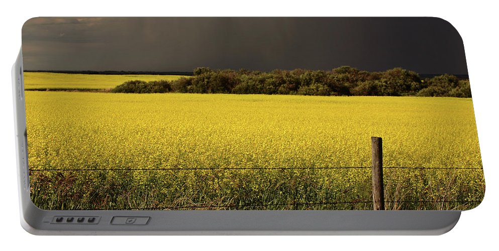 Clouds Portable Battery Charger featuring the digital art Rain Front Approaching Saskatchewan Canola Crop by Mark Duffy